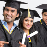 Three Indian graduates in robe with graduation certificate.